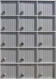 Mailboxes. Mailbox doors receeding into the distance left Royalty Free Stock Photography