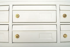Mailboxes. Group of white mailboxes in a neighborhood Royalty Free Stock Images