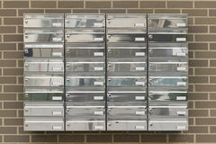 Mailboxes in a building houses Stock Photo