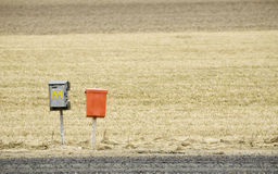 Mailboxes on a country road. Two old mailboxes on a country road Stock Images