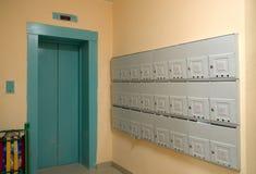 Mailboxes, elevator door Stock Images