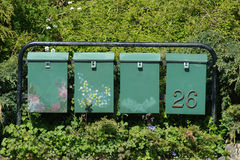 Mailboxes among flowers Stock Image