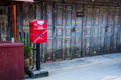Mailboxes are located of the wooden house. stock images