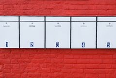 Mailboxes on red wall Royalty Free Stock Image