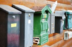 Mailboxes in a Row. Different Mailboxes in a Row with selective Focus Royalty Free Stock Photo