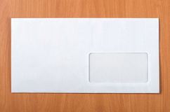 Mailing envelope. With a window on the table Royalty Free Stock Photography