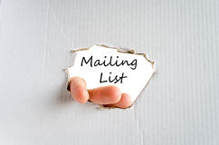 Mailing list concept. Hand and text on the cardboard background Mailing list concept Stock Images