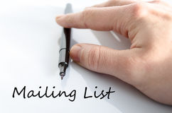 Mailing list concept. Pen in the hand  over white background Mailing list concept Royalty Free Stock Images