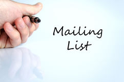 Mailing list concept. Pen in the hand  over white background Mailing list concept Stock Image