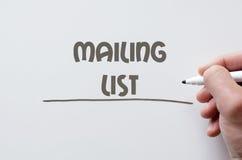 Mailing list written on whiteboard. Human hand writing mailing list on whiteboard Stock Photos