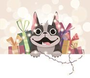 Mailing template for the new year. A cheerful French bulldog with gifts and a herring. Boke in the background Stock Image