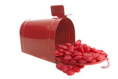 Mailing valentine's day candy. Valentine's Day treats being mailed in red metal box stock photos