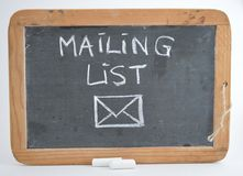 Mailinglist. A blackboard with written text mailinglist Stock Image