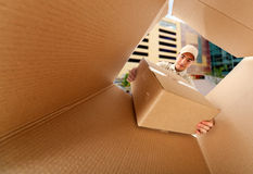 Mailman delivering a package Stock Images