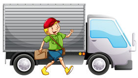 A mailman and a delivery truck Royalty Free Stock Photos
