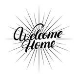Main à la maison bienvenue écrite le lettrage Images stock
