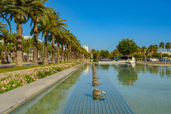Main alley with fontane in Salou. Spain, blue sky Stock Image