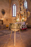 Main altar of gothic evangelical church in Stitnik from 14 - 15 cent. and bronze Baptistery (1454) by master Jana from Spisska Sob Stock Photos
