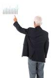 Main asiatique d'homme d'affaires dirigeant le graphique de gestion Photographie stock