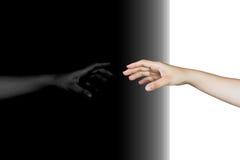 main atteignant avec la réflexion Photographie stock libre de droits