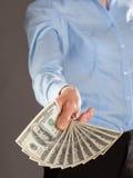 Main atteignant l'argent Images libres de droits