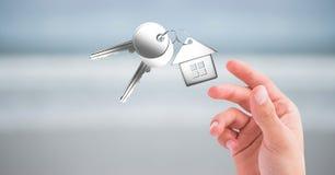 main atteignant pour les clés 3d Photographie stock