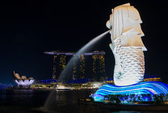 Main attractions of Singapore: Merlion, Marina Bay and Artscienc. The Marina bay harbor and attractions surround it in the night Stock Image