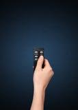 Main avec à télécommande Photos stock