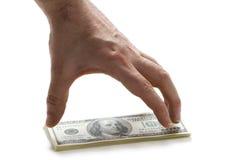 Main avec 100 billets d'un dollar Image libre de droits