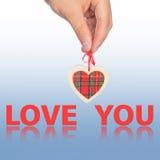 Main avec amour de coeur et de mot vous Photographie stock