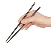 Main avec des baguettes Image stock