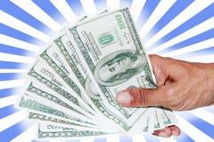 Main avec des billets de banque du dollar Photos stock