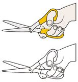 Main avec des ciseaux Photo libre de droits