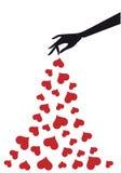 Main avec des coeurs,   Images stock
