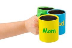 Main avec des cuvettes de famille Image stock