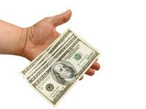 Main avec des dollars Photo stock