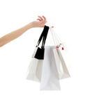 Main avec des sacs à provisions Image stock
