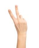 Main avec deux doigts vers le haut dans le symbole de paix ou de victoire Photo stock