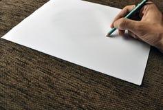 Main avec l'écriture de crayon Photographie stock