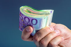 Main avec l'argent Images stock