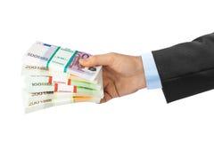 Main avec l'argent photographie stock