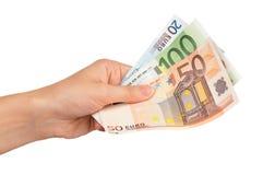 Main avec l'euro Photo stock