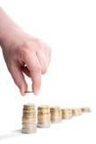 Main avec l'euro pièce de monnaie et piles de pièces de monnaie Image libre de droits