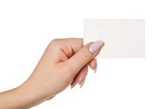 Main avec la carte de visite professionnelle de visite Photographie stock libre de droits