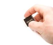 Main avec la gomme à effacer Image stock
