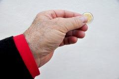 Main avec la pièce de monnaie Images stock