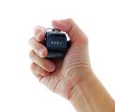 Main avec le compteur avec le numéro 0001 Photo stock