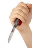 Main avec le couteau Photographie stock libre de droits