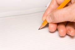 Main avec le crayon Images libres de droits