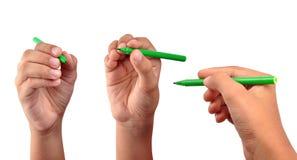 Main avec le crayon lecteur Photographie stock libre de droits